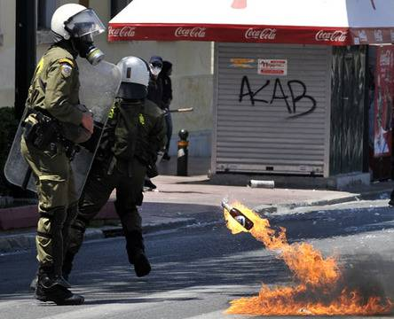 Riot police use tear gas as protesters throw petrol bombs in Athens